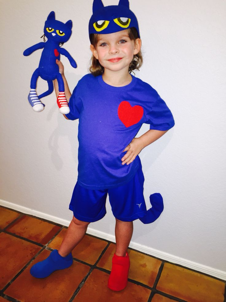 Pete the Cat costume! Red and blue socks covering tennis shoes.  Felt with sticky backing bought at JoAnne's (for eyes, heart), Felt hat was found at Joanne's Fabric, but it with a shark fin.  I cut off the fin and made ears out of fin.  Tail is blue tube sock with wire hanger for shape and stuffed with cotton.
