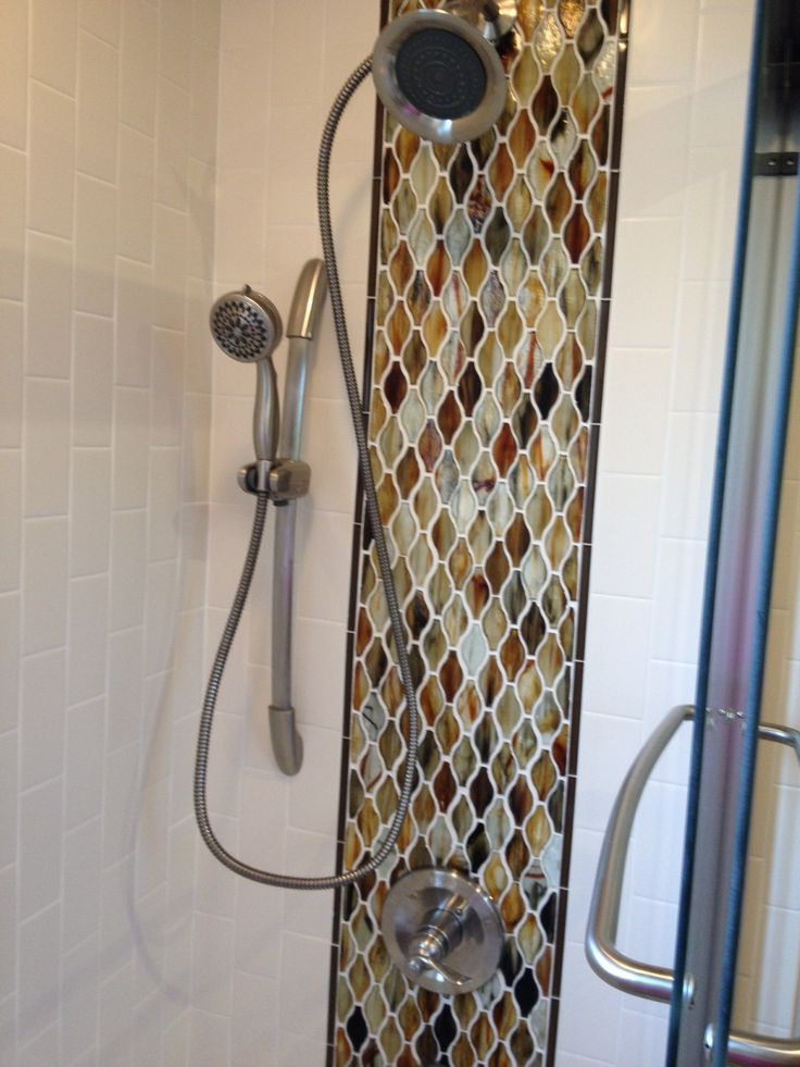 Main level bath remodel features Hirsch glass tiles in shower, repeated in area above vanity.