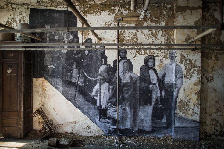 """JR Brings Ellis Island's Abandoned Hospital to Life - NYTimes.com In """"Unframed — Ellis Island,"""" the artist JR has frozen this and other defining moments in time."""