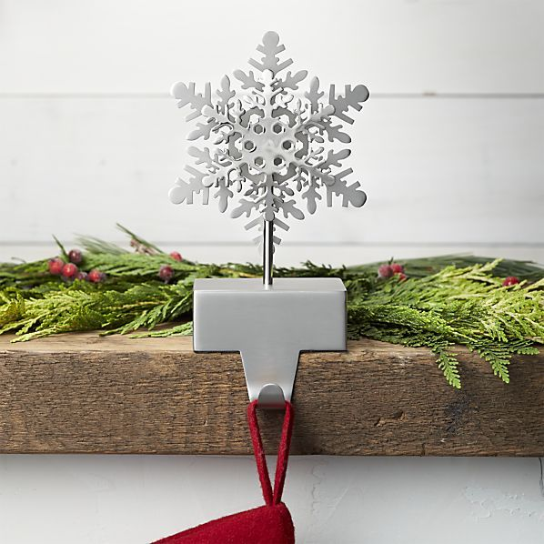 A mix of matte and shiny sparkles a beautiful silver snowflake on this sturdy stocking hook. Line up on the mantel in multiples or mix with other stocking hook designs for an eclectic look.