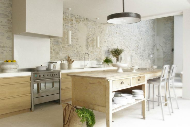 Wonderfully bright and open kitchen space with a natural stone wall. #modern #kitchen #bright #stonewall