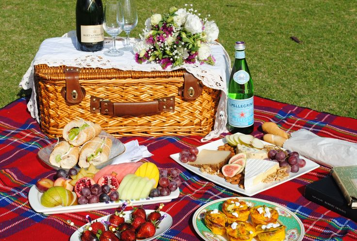 a romantic picnic with food and flowers