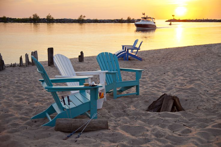 Sunsets on the beach in these recycled plastic Adirondack chairs - yes please!
