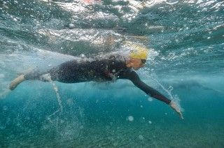 Swim like a triathlete not a swimmer