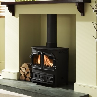 wood burning stove set INTO wall  But I would rather it be open between two rooms so the heat can get around.