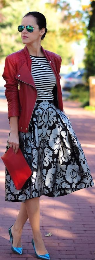red leather moto jacket / black and white / skirt / striped / print / blue pumps / shoes / clutch / bag