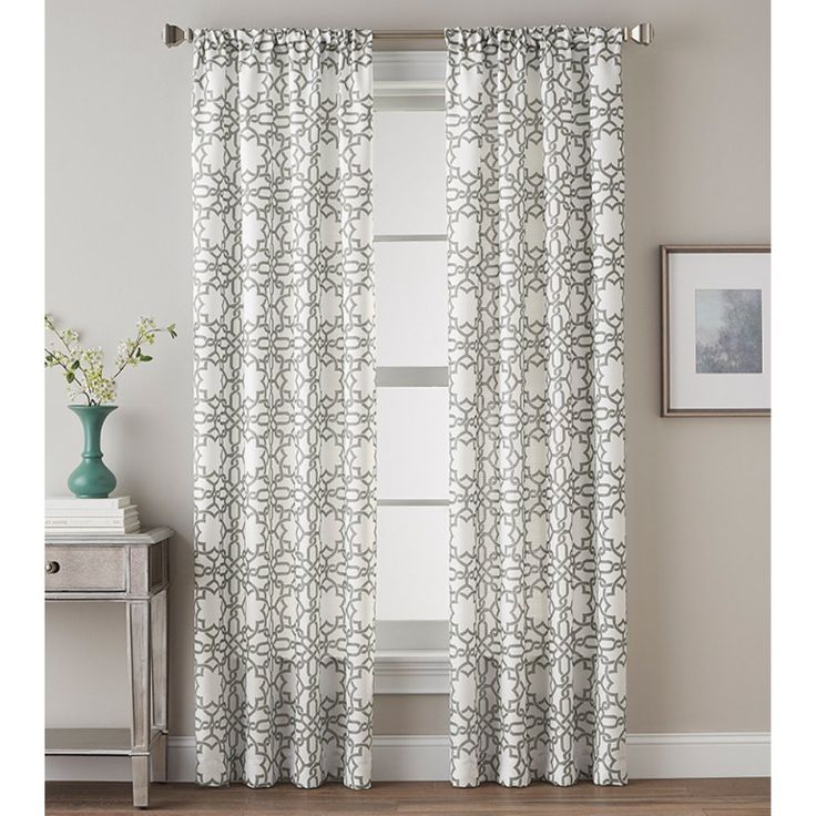 This grey and white single curtain panel is perfect for freshening the look of your bedroom, dining room, or living space.