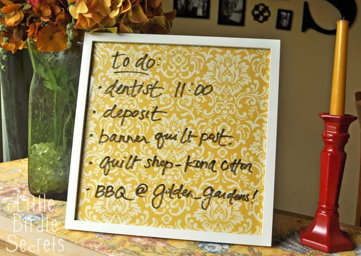 Pretty DIY dry-erase board.  All you need is a picture frame and some cute paper.