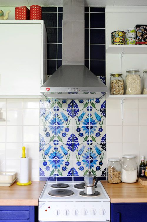 one tiny little blue and white tile backsplash above the oven and other blue accents in the kitchen.  ...Corners of Home: Finland, scandinavian, boho, eclectic, clean