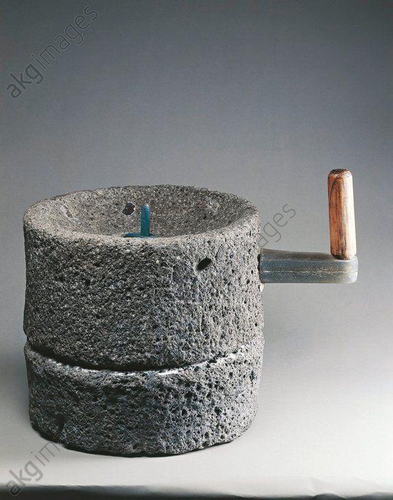 *POMPEII, ITALY ~ Roman civilization, 1st century A.D. Lava cylindrical millstone used for grinding wheat. From Pompei, House of the Blacksmith