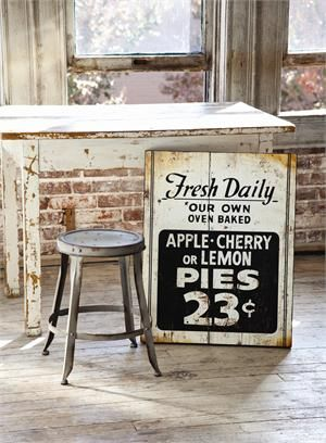 Inspired by an antique shop find, this Fresh Pie Sign is reminiscent of one you might see by an old farm stand in the country or at the local bakery down on main street. The vintage style graphics and weathered finish give it plenty of farmhouse charm. A friendly addition to any kitchen or dining room.