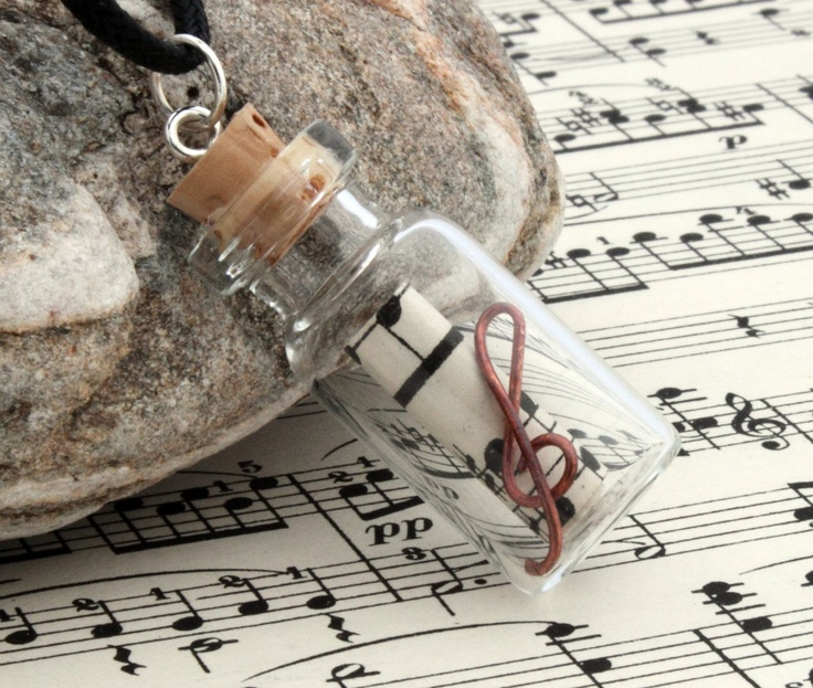 Medium music lovers glass vial pendant with scroll of upcycled vintage sheet music and a copper wire treble clef.
