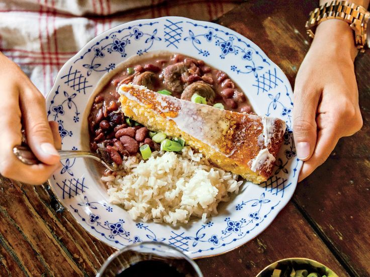 Emily's Red Beans and Rice Recipe | New Orleans Chef Alon Shaya might be the chef in the family, but he can't take credit for this meal's main event: wife Emily's red beans and rice. Her spicy, tender beans feed a large crowd, especially when served over fluffy, buttery rice.