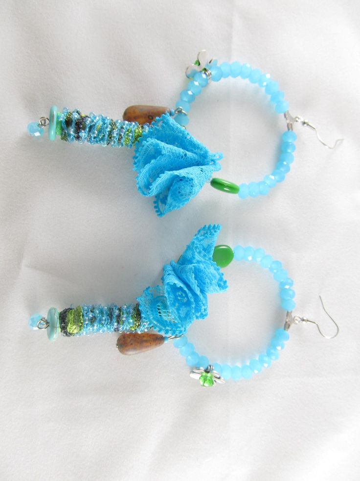 Handmade lace earrings (1 pair)  Made with handmade beads with fiber and seed beads, lace, glass beads, metal flower, semiprecious stones and antiallergic hangings.