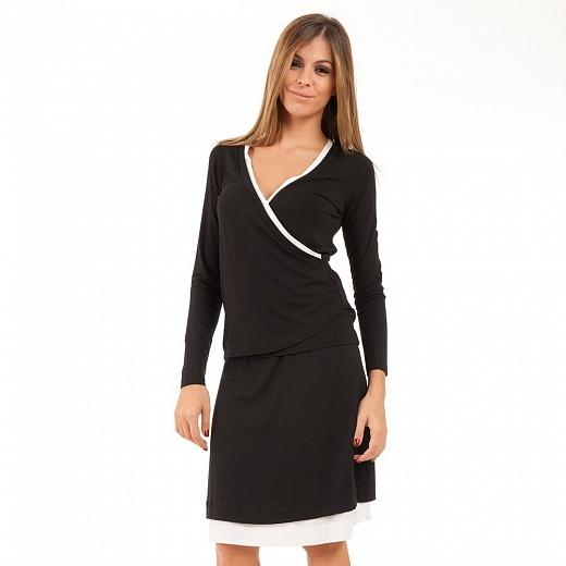 ajímavá černá sukně sbílým lemem má áčkovou siluetu. Sukně zpříjemného materiálu se hodí do práce inarande.