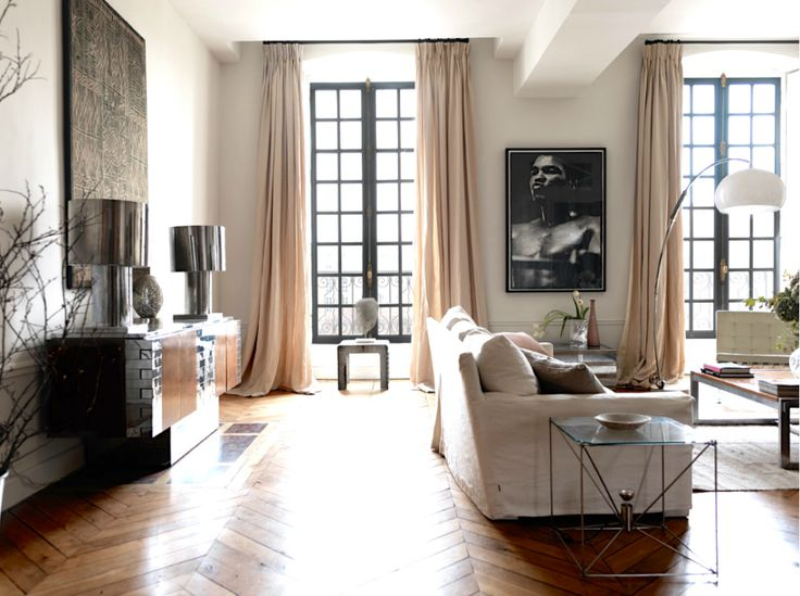 """Place de Vosges apartment.  It was designed by Marianne Tiegen for a British family who wanted """"furnishings to honor the history of the building with its lofty windows and tall ceilings, but to be perfectly usable for a busy, modern, young family."""""""