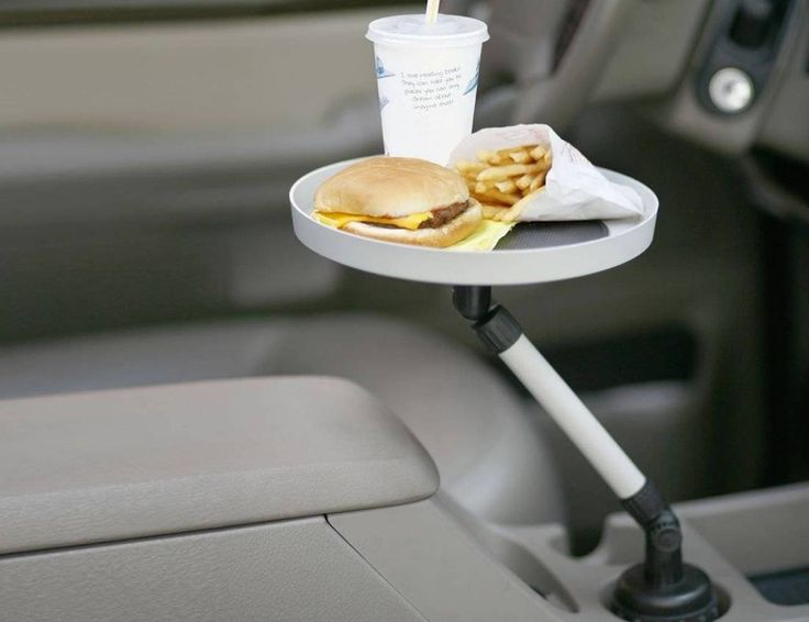 Carrying your lunch on your lap inside the car will be gone forever once you install this Cup Holder Swivel Tray.