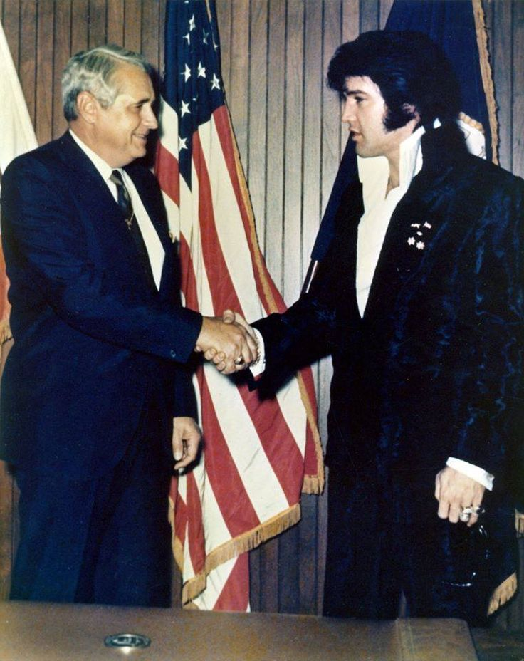 Getting a hug at LAPD headquarters on December 3, 1970 - Elvis was there to get a gold commissioner's badge from Chief Ed Davis