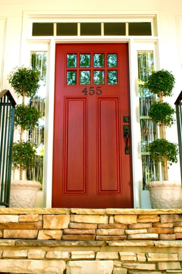 Red front door with small windows along the top with transom and full