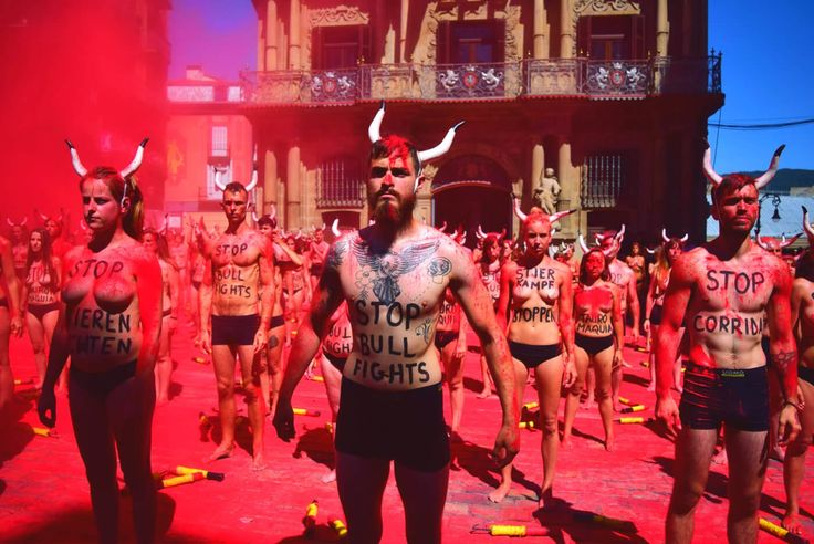 Around 100 activists wearing bull horns and not much else reminded festival-goers that bulls die a bloody death in Pamplona.
