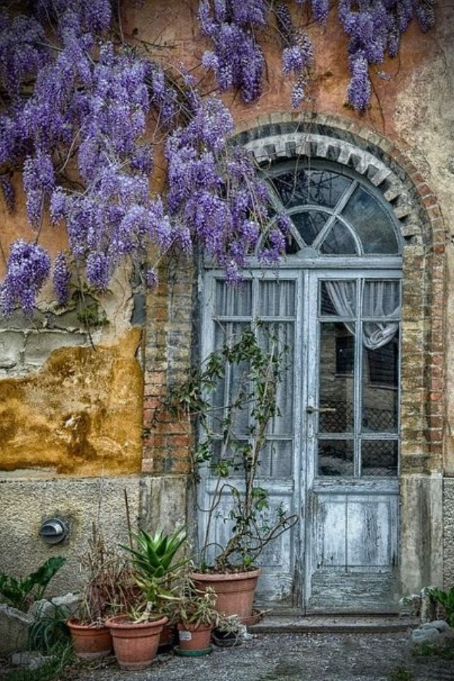 Very Old Arched Door in Italy