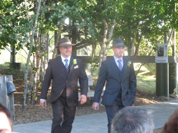 Who says your wedding suit has to be black? These gentlemen opted for a non traditional look that complimented their casual outdoor wedding!