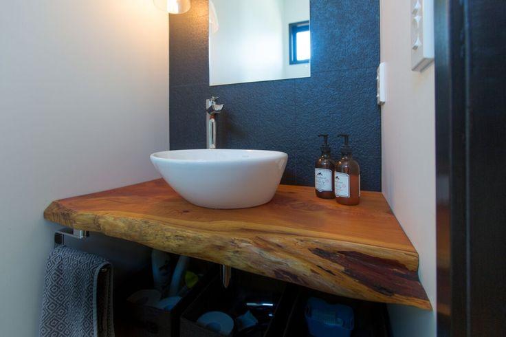 Macrocarpa feature in guest bathroom