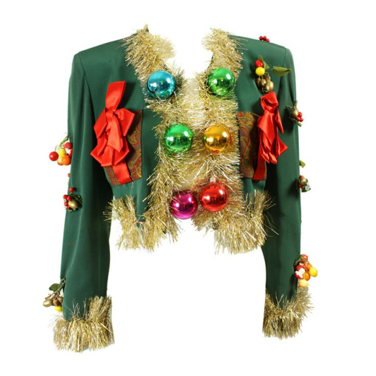 Moschino 'Christmas Tree' jacket | Italy, 1990's | Jacket is made of forest green gabardine that is trimmed with gold and silver tinsel. Multicolored spherical bulbs run down the center front and are grouped at the cuffs. Varied 'ornaments' are attached throughout. Two front patch pockets at bust are made of paisley fabric and have large red satin bows