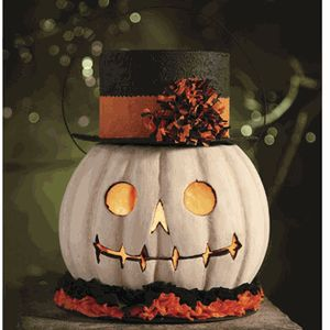 Pumpkin Has a great vintage look, would be wonderful to recreate - LED candle inside a faux ghost carving pumpkin?