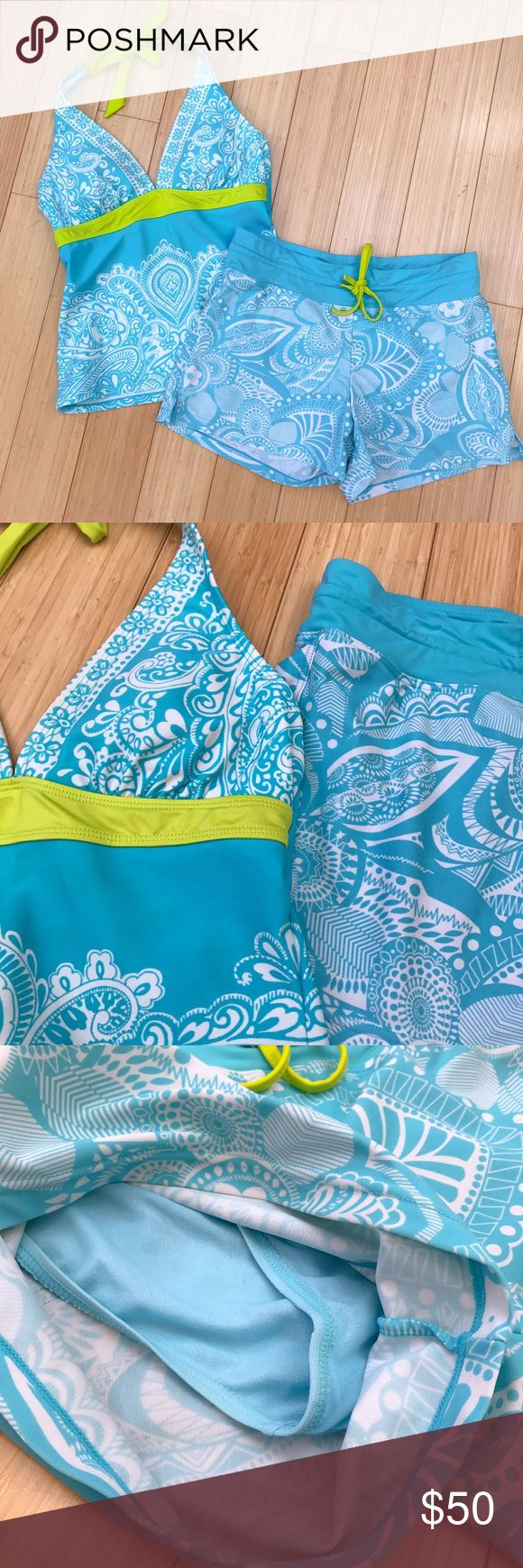 ATHLETA tankini swimsuit, boy shorts, S. Super nice Athleta tankini bathing suit, size small. Turquoise with white swirls and chartreuse trim. Shelf bra in the top, halter style, removable bra cups present. The bottoms are swim shorts with an internal bikini lining to keep things cozy, small back pocket. Everything is in great condition, the shorts might be the tiniest shade lighter. This is an excellent, quality swimsuit for people who prefer to do more than just sun bathe. Athleta Swim…
