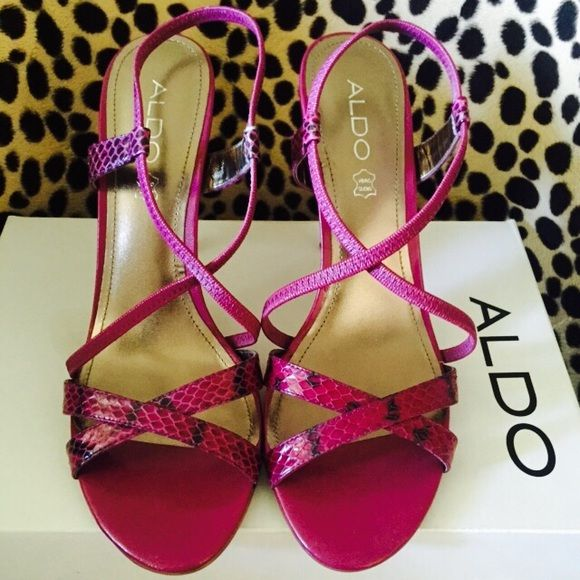 Aldo pink spike heel animal print sandals. Adorably sexy. Aldo strappy heels in leather magenta snake print. Size 8. Worn once. MINIMAL scuffing on heel. Original box. Add a burst of color to your shoe collection! ALDO Shoes Sandals