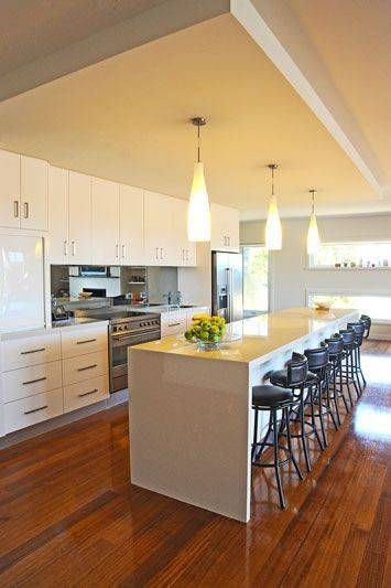 7 - This Stylish kitchen by Northern Kitchens features 40mm LG acrylic benchtops in Beige Island and gloss finish vinyl doors in Antique White USA