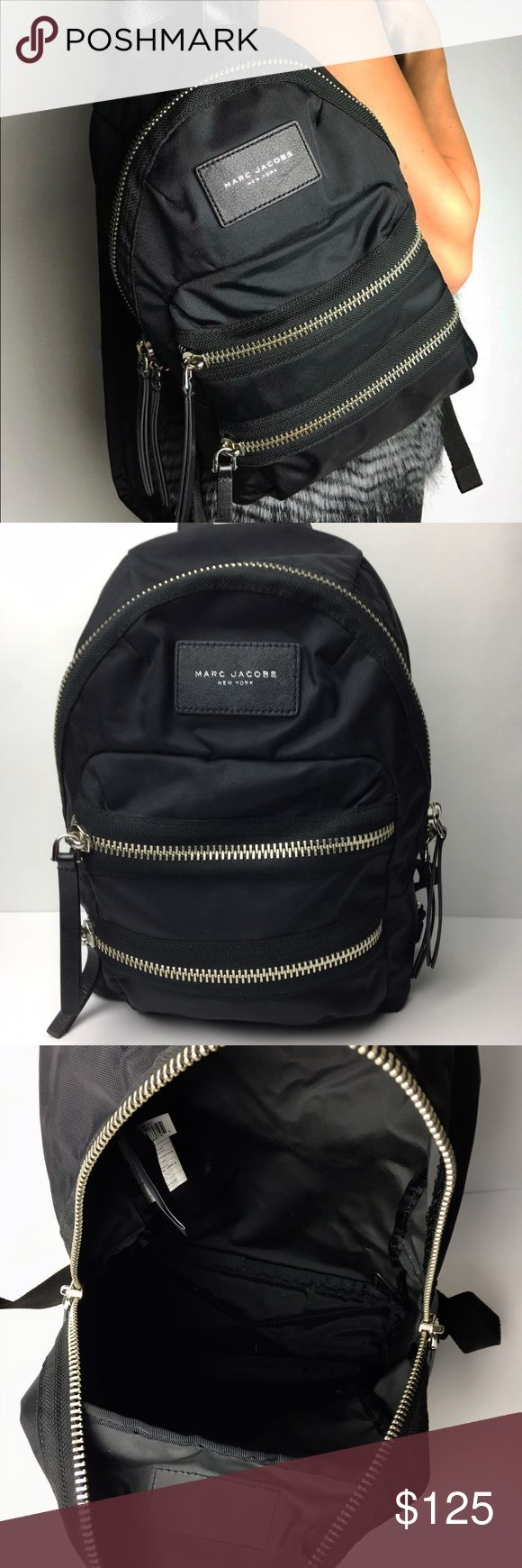 "Authentic Marc Jacobs Black Nylon Backpack This is a great UNISEX bag for travel, everyday use, computer/laptop messenger bag, diaper bag or just regular shoulder bag tote for all your stuff! This is a standard sized backpack compared to a medium/large handbag. This can be used as a shoulder purse or casual backpack. Backpack is BRAND NEW without tags attached.    DETAILS - Measurements: 12"" L x 16.5"" H x 3 5 W - Large roomy interior - Embossed Leather Marc Jacobs Logo on front - 2 front…"