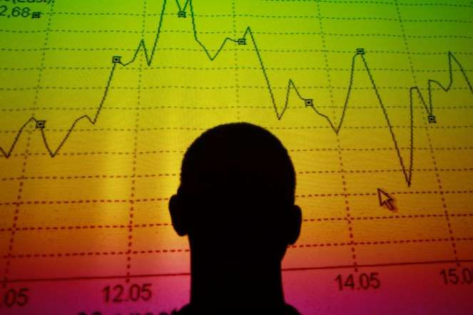 """""""Every Millennial Should Know These Investing Terms Cold"""" Man silhouetted by stock graph. - Tony Gentile/Reuters"""