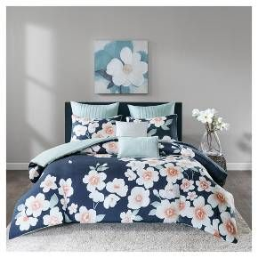Your bedroom décor will be in full bloom with the Carmine 7 Piece Cotton Duvet Cover Set. A lovely floral pattern is printed across the top of the cotton sateen duvet cover, creating a striking and beautiful contrast. The light-blue reverse provides a soft touch to the design and gives the duvet cover added charm. A button closure, on the duvet cover, allows it to be filled with a comforter insert so you can stay warm during the colder months. Matching shams showcase the floral patte...