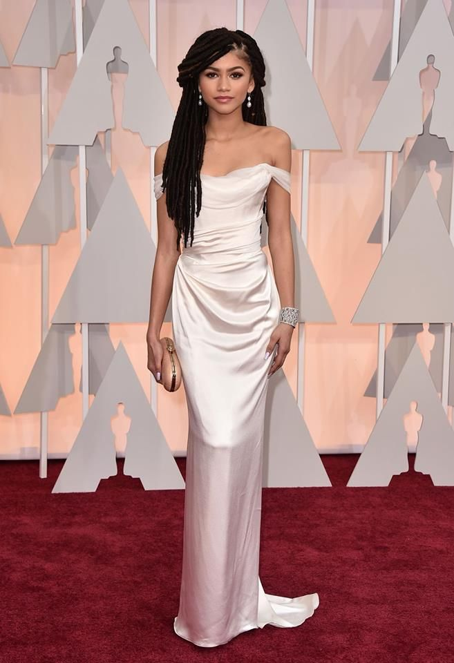 Zendaya chose to wear a Vivienne Westwood white Ball Tie dress in silk satin and the Grace evening clutch to last night's 87th Annual Academy Awards.