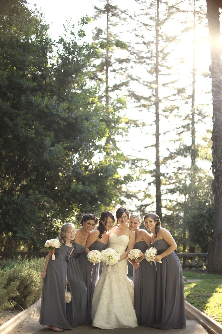 The colors are perfect. I love the white bouquet with the charcoal dress. The dresses are cute too! Lovely long grey bridesmaids dresses   @Daniel Morgan Cruz