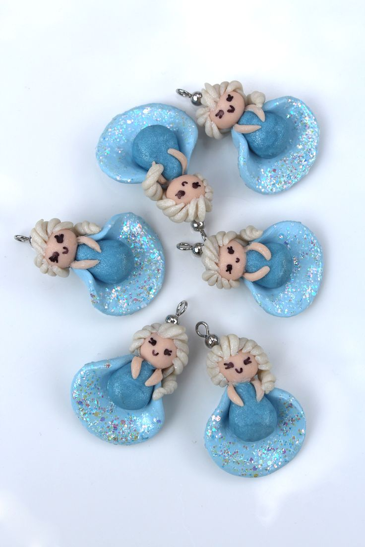 I just opened my very own Etsy shop featuring polymer clay charms from beloved Disney movies and video games. I started with Elsa inspired by the character from Disney's Frozen.