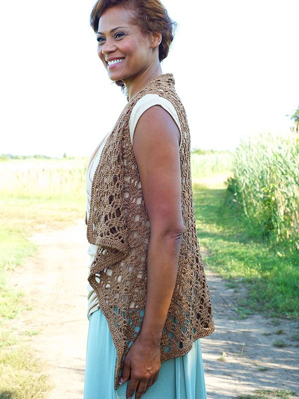 """Berne Vest Free Crochet Pattern  Perfect for spring and summer wear! This light and lacy vest crochet  pattern is just right for layering over tanks and tees without adding  weight. It has a modern silhouette and drape front. Crochet it out of  Berroco Captiva yarn for a hint of elegant shine.  Fits Bust Sizes: 30 (34,38,42,46)""""  Completed Chest Measurements: 44.5(48.5,54,61.5,69)"""" (including  edging)Note: This garment was designed with approximately 3"""" of ease at  the bust. There…"""