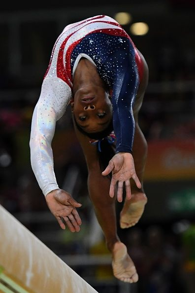 US gymnast Simone Biles competes in the Beam event during the women's team  final Artistic Gymnastics at the Olympic Arena during the Rio 2016 Olympic.