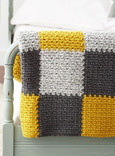 Free Patchwork Blanket Crochet Pattern - With funky color-blocking and modern colors, this crocheted afghan will bring a room to life. Shown in Bernat Softee Chunky.