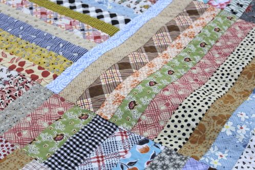 Strip Quilt from Scraps hand quilted