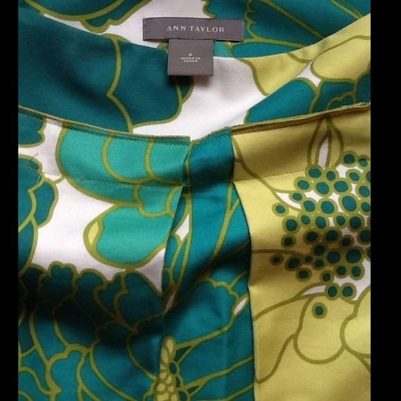Beautiful vibrate color skirt by Ann Taylor only wore one time .. Smoke free home..55%cotton45%silk fully lined.floral print in white , turquoise blue, teal,& lime green.. Contour waistband with hidden side zipper..front pleat..please see 1st picture for best true color of skirt.. Retail price $88.00 Thank you for looking ;)