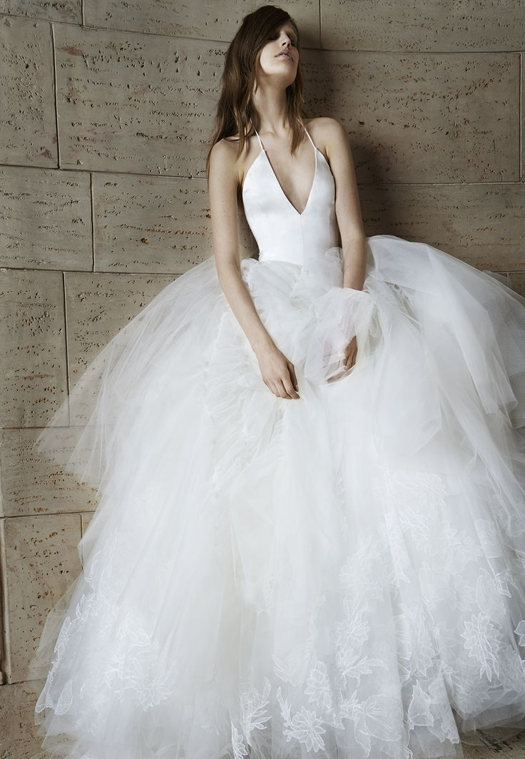 Look 16. Ivory deep V-neck silk charmeuse halter ball gown with ruched tulle skirt and Chantilly lace appliqué accents
