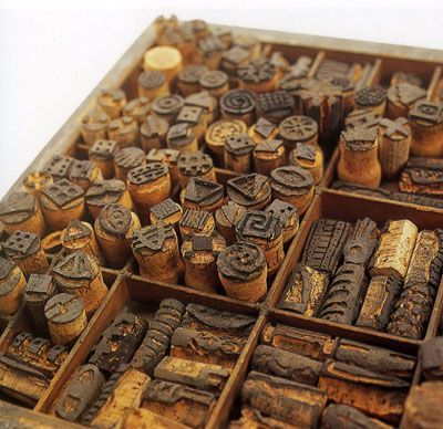 Carved stamps from old wine corks! for texture or patterns on cl...