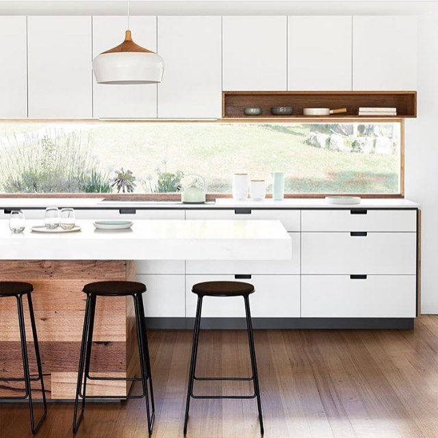 A stunning mid-century home transformation by @cantileverinteriors - crisp white cabinetry & surfaces including Caesarstone Calacatta Nuvo applied atop a recycled timber base!   @gemmola  Styled by @ruthwelsby  Repost @thewesthomes  #architecture #inspiration #design #kitchenlove #kitcheninspo #kitchen #designinspo #interior #interiordesign #caesarstone