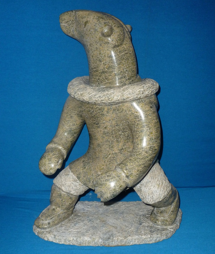 """Item # S7050 Price: C$4,750 C$3,800 (Sale Price) Subject: Link   Bear Shaman Dated: 1995 - Signed Artist: Link   Ikkidluak, Iola-Abraham      Community:  Link   Cape Dorset       Size: inches/cm 22.5"""" x 15"""" x 11"""" 57.2 cm x 38.1 cm x 27.9 cm   Description: This large and impressive piece captures the strength and power of the great northern predator with the intelligence and human quality of the shaman."""