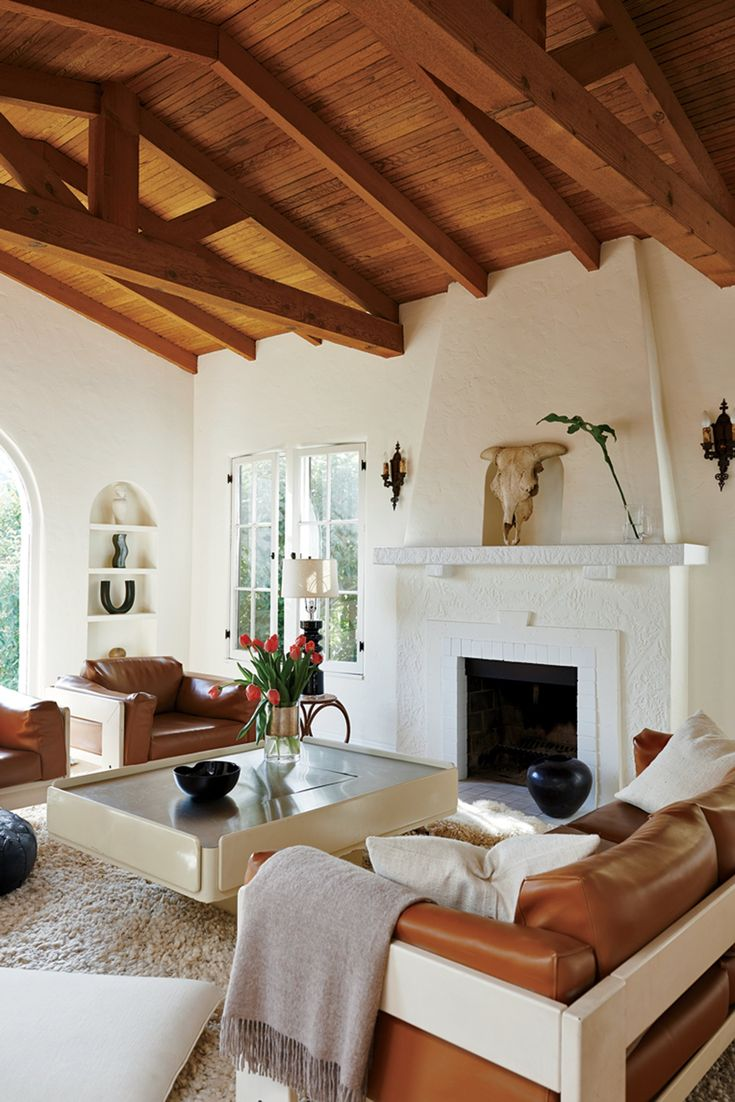 In the home of designer Sophie Buhai, 1970s chic, complete with shag rug, mixes with the cozy Mediterranean-inspired architecture of her 1930s Silver Lake bungalow, creating a California-cool atmosphere.