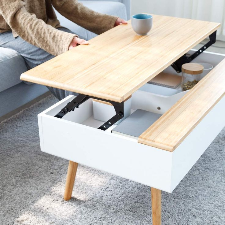 A stylish, white & bamboo lift-top coffee table fo…