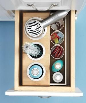 If you're blessed with deep drawers, treat one to a bamboo caddy, with slots for brushes, flatirons, and more.